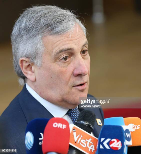European Parliament Chief Antonio Tajani answers the questions of press members as he arrives to attend the EU members' informal meeting of the 27...