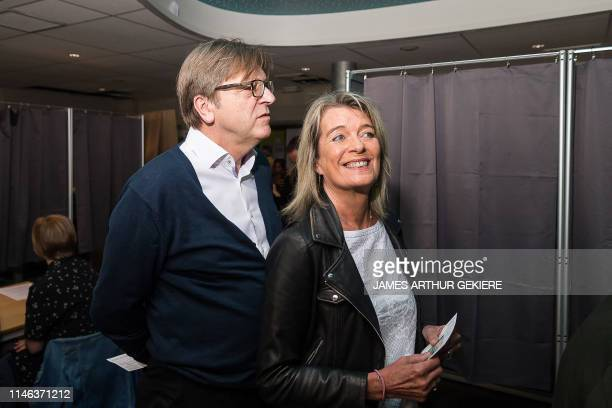 European parliament member for Open Vld Guy Verhofstadt and his wife Dominique Verkinderen arrive to cast their ballot at a polling station in...