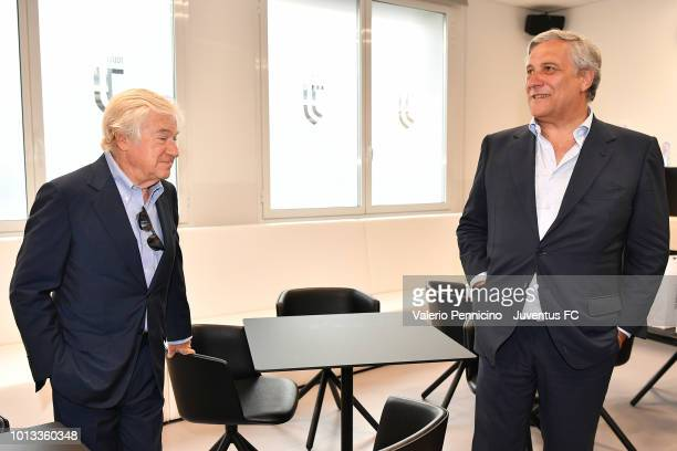 European Parliament President Antonio Tajani and Paolo Garimberti talk during the visits to Juventus Headquarters JTC Continassa on August 8 2018 in...
