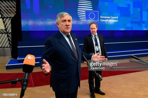European Parliament President Antonio Tajani answers journalists' questions upon his arrival at the European Council in Brussels on October 18 2018...