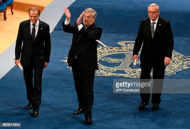 European Parliament president Antonio Tajani European Council president Donald Tusk and European Commission president JeanClaude Juncker acknowledge...