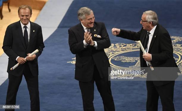 European Parliament president Antonio Tajani European Council president Donald Tusk and European Commission president JeanClaude Juncker celebrate...