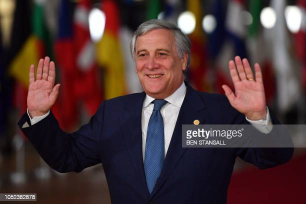 European Parliament President Antonio Tajani gestures upon his arrival at the European Council in Brussels on October 17 2018 British Prime Minister...