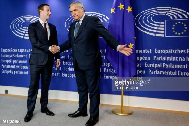 TOPSHOT European Parliament President Antonio Tajani shakes hands as he welcomes Facebook CEO Mark Zuckerberg at the European Parliament prior to a...
