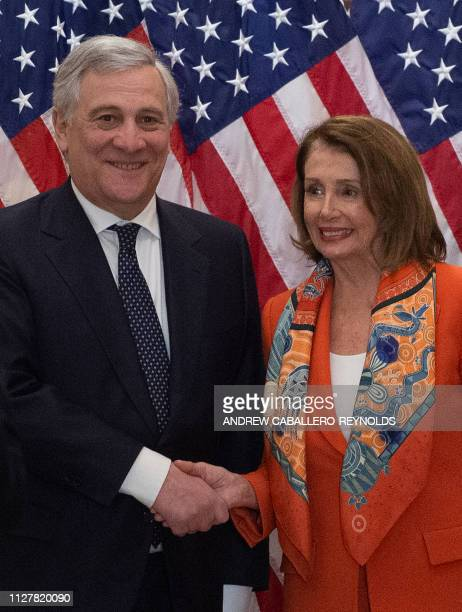 European Parliament President Antonio Tajani shakes hands with US House Speaker Nancy Pelosi before a meeting at the US Capitol in Washington DC on...