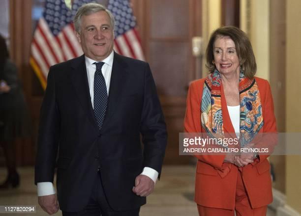 European Parliament President Antonio Tajani walks with US House Speaker Nancy Pelosi before a meeting at the US Capitol in Washington DC on February...