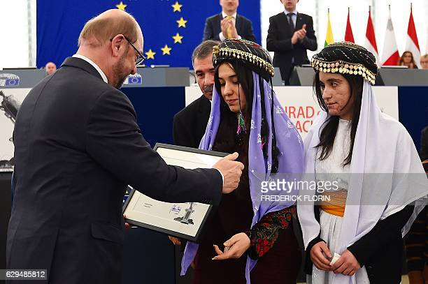 European Parliament President Martin Schulz gives to Nadia Murad and Lamia Haji Bashar public advocates for the Yazidi community in Iraq and...
