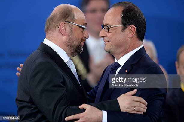 European Parliament President Martin Schulz is hugged by French President Francois Hollande during the International Charlemange Prize Of Aachen 2015...