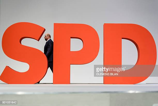 European Parliament President Martin Schulz walks past a giant SPD sign at the annual federal congress of the German Social Democratic Party in...