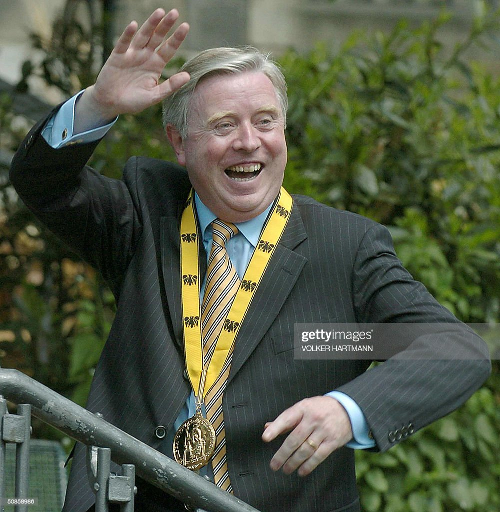 European Parliament President Pat Cox waves after his awarding the International Aachen Charlemagne peace prize (Karlspreis) in the coronation hall of Aachen's city hall on 20 May 2004. Cox is awarded the prize, one of the most important and coveted awards for services to European unification, for his contribution to the concept of Europe and European peace. The distinguished list of Charlemagne Prize winners reflects the history of the European process of unification. It has been awarded to the founding fathers of the United Europe such as de Gasperi, Schuman, Monnet and Adenauer, and to those who have embodied hope for integration. So the Charlemagne Prize is not only an expression of gratitude for lasting services for the unity of Europe, but also an encouragement and an expression of hopes and expectations directed towards the future.