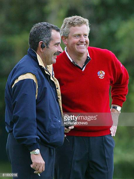 European player Colin Montgomerie with his team Captain Sam Torrance during his fourball game with Bernhard Langer against Phil Mickelson and David...