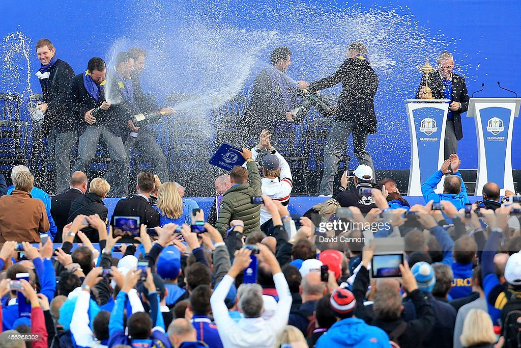 European players celebrate winning the Ryder Cup as they spray champagne on stage after the Singles Matches of the 2014 Ryder Cup on the PGA Centenary course at the Gleneagles Hotel on September 28, 2014 in Auchterarder, Scotland.