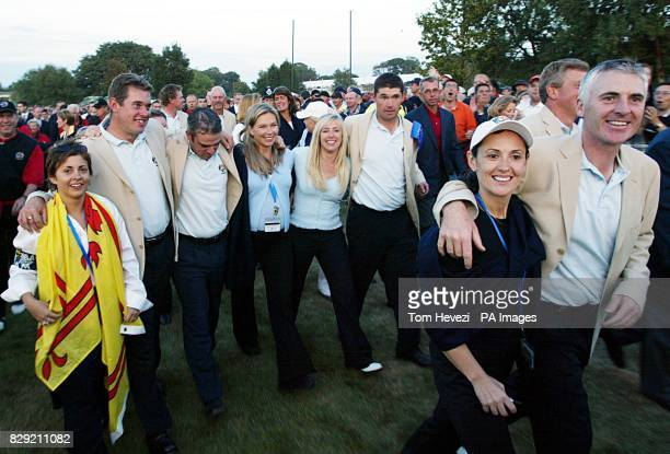 European players from left to right Lee Westwood Paul McGinley Padraig Harrington and Phillip Price with their wives Laura Westwood Alison McGinley...