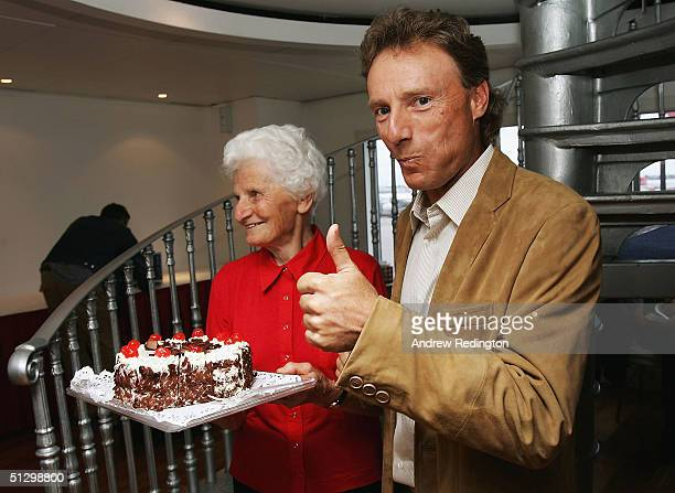 European Ryder Cup Captain Bernhard Langer with his mother Wally as his gives the thumbs up to the Black Forest Gateaux which is made from his...