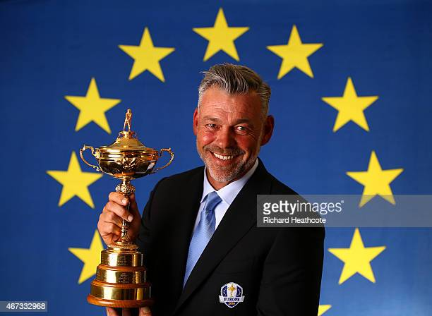 European Ryder Cup Captain Darren Clarke of Northern Ireland poses with the Ryder Cup trophy during a Ryder Cup Photocall at the Sofitel hotel on...