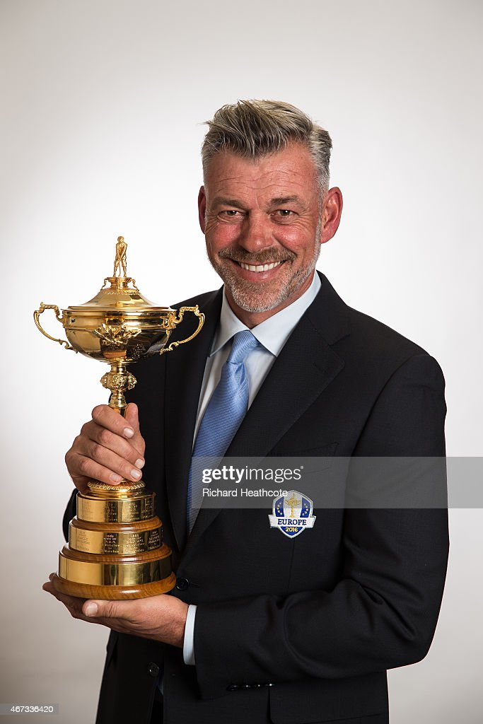 European Ryder Cup Captain Darren Clarke of Northern Ireland poses with the Ryder Cup trophy during a Ryder Cup Photocall at the Sofitel hotel on March 23, 2015 in London, England.