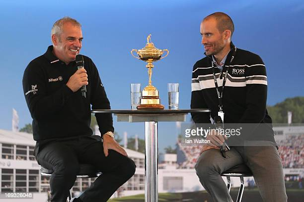 European Ryder Cup captain Paul McGinley of Ireland onstage with Andrew Cotter answers questions from spectators in the public village during the...