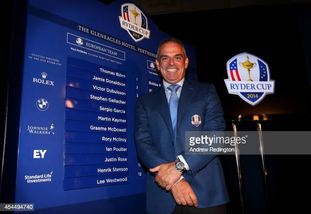 European Ryder Cup captain Paul McGinley of Ireland poses next to the final lineup after announcing Stephen Gallacher of Scotland Ian Poulter of...