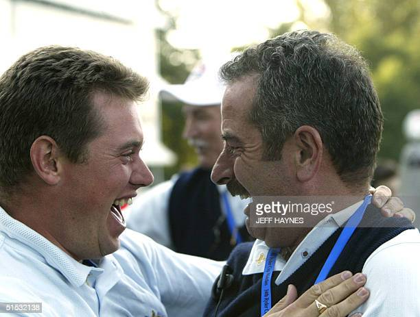 European Ryder Cup golfer Lee Westwood congratulates of England his team Captain Sam Torrance after their victory against United States 15,5 to 12,5...