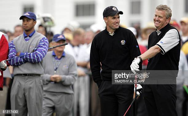 European Ryder Cup team members Colin Montgomerie of Scotland and Padraig Harrington of Ireland talk to each other during their Four-Ball Match as...