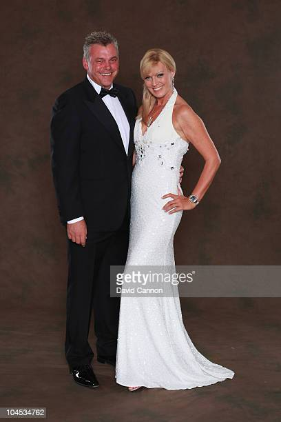 European Ryder Cup team vice-captain Darren Clarke poses with his partner Alison Campbell prior to the 2010 Ryder Cup Dinner at the Celtic Manor...