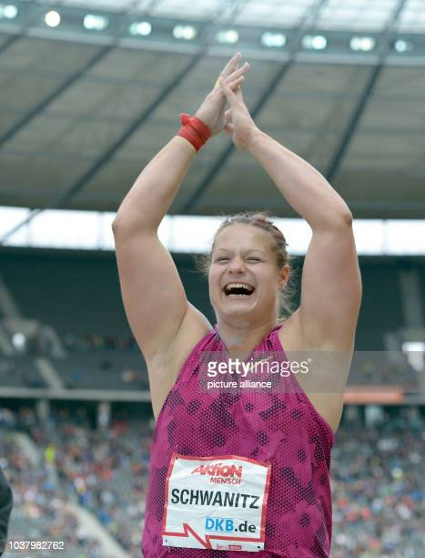 European shot put champion Christina Schwanitz cheers during the Internationales Stadionfest annual track and field athletics meet at the...