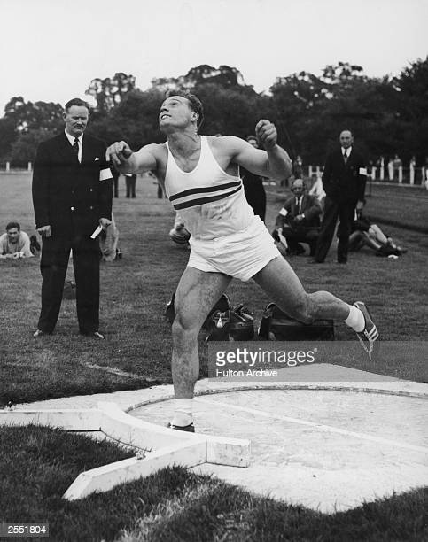European shotput champion Arthur Rowe of Britain wins the shotput event with a 58foot throw at the annual triangular Athletics match between the...