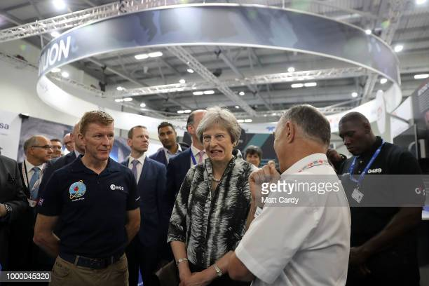 European Space Agency astronaut Tim Peake speaks with British Prime Minister Theresa May as she opens the Farnborough Airshow on July 16, 2018 in...