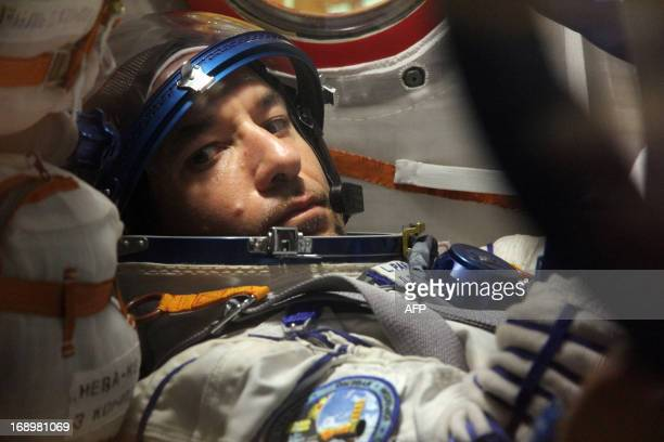 European Space Agency's Italian astronaut Luca Parmitano is seen inside of the space capsule as he takes part in preflight training at the...