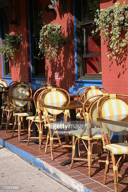 european style sidewalk cafe with yellow chairs - soho new york stock pictures, royalty-free photos & images