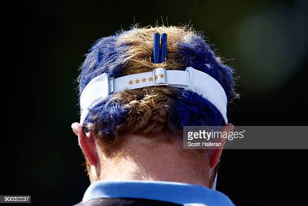European Team caddie John Anderson waits on a tee box during the Sunday singles matches at the 2009 Solheim Cup at Rich Harvest Farms on August 23...