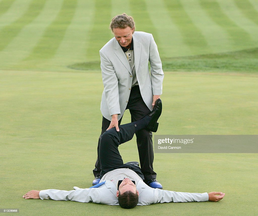 European team captain Bernhard Langer jokes with Sergio Garcia during the Closing Ceremonies after Europe's defeat of USA at the 35th Ryder Cup Matches at the Oakland Hills Country Club on September, 19 2004 in Bloomfield Township, Michigan.