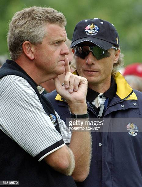European team captain Bernhard Langer of Germany talks to team leader Colin Montgomerie of Scotland during the afternoon Foursome matches 17...