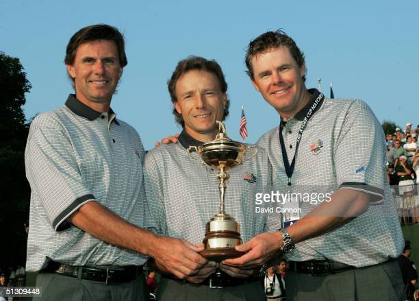 European team captain Bernhard Langer of Germany with his assistant captains Anders Forsbrand and Joakim Haeggman of Sweden with the trophy during...