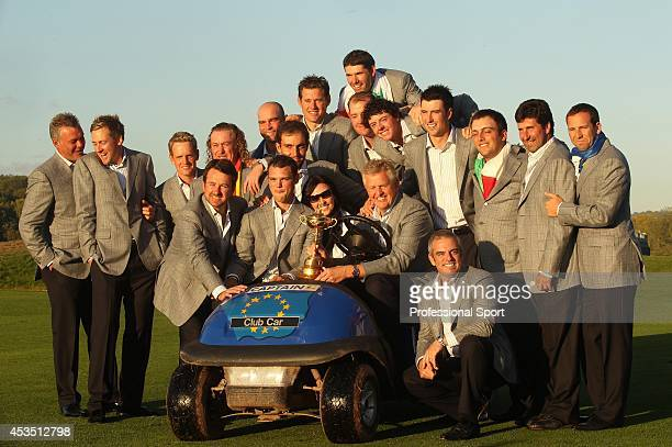 European Team Captain Colin Montgomerie poses with his wife Gaynor and his team with the Ryder Cup following Europe's 145 to 135 victory over the USA...