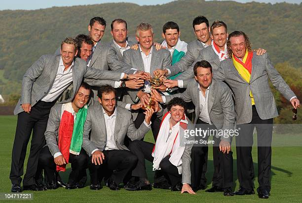 European Team Captain Colin Montgomerie poses with the Ryder Cup and his team following Europe's 145 to 135 victory over the USA at the 2010 Ryder...