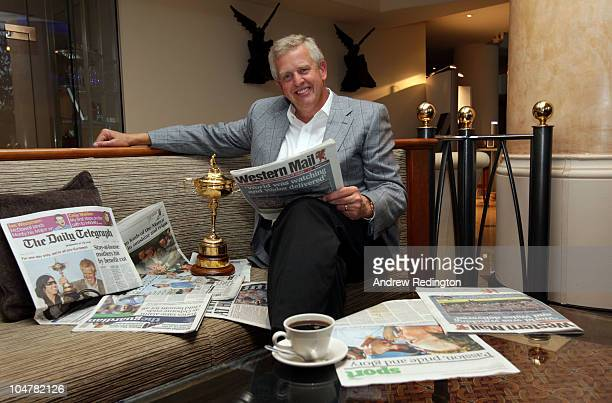European Team Captain Colin Montgomerie poses with the Ryder Cup and the morning papers following yesterday's European team 145 to 135 victory over...