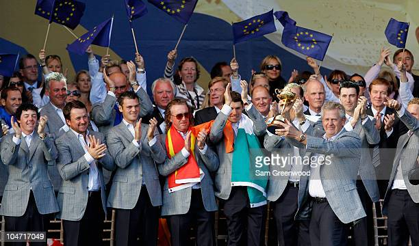 European Team Captain Colin Montgomerie poses with the Ryder Cup alongside his team at the closing cermonies following Europe's 145 to 135 victory...