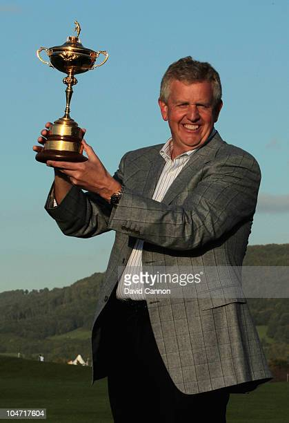 European Team Captain Colin Montgomerie poses with the Ryder Cup following Europe's 145 to 135 victory over the USA at the 2010 Ryder Cup at the...