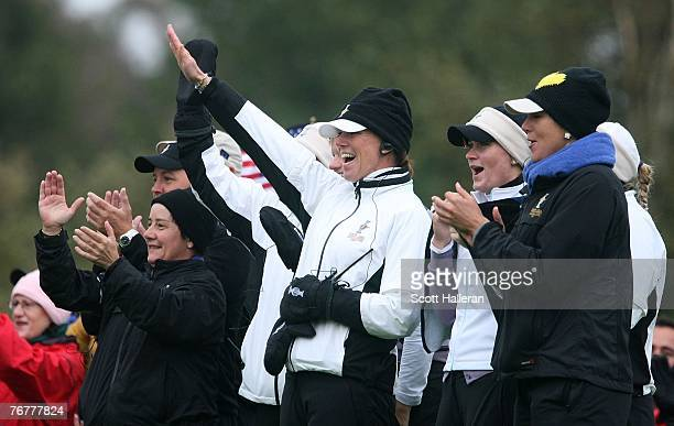 European Team Captain Helen Alfredsson celebrates with her team on the 18th green during the completion of the afternoon fourball matches of the 2007...