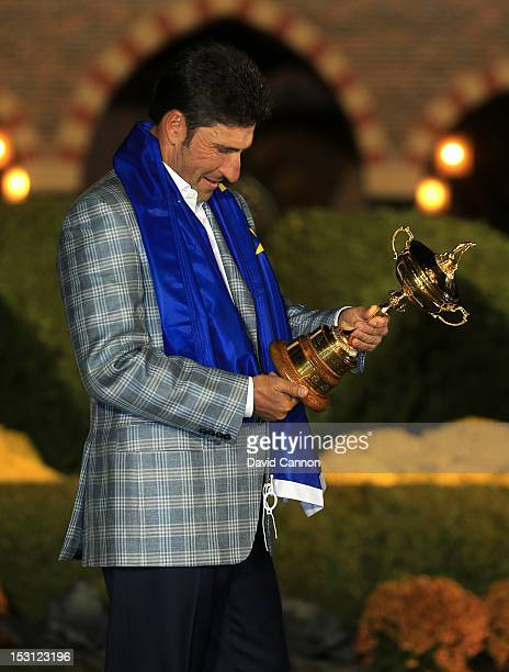 European team captain Jose Maria Olazabal gazes at the Ryder Cup after Europe defeated the USA 145 to 135 to retain the Ryder Cup during the Singles...