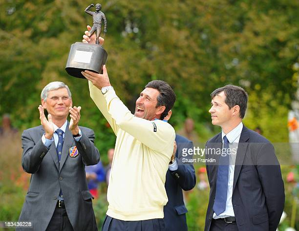 European team captain Jose Maria Olazabal holds the trophy after winning the final days singles matches at the Seve Trophy at Golf de...