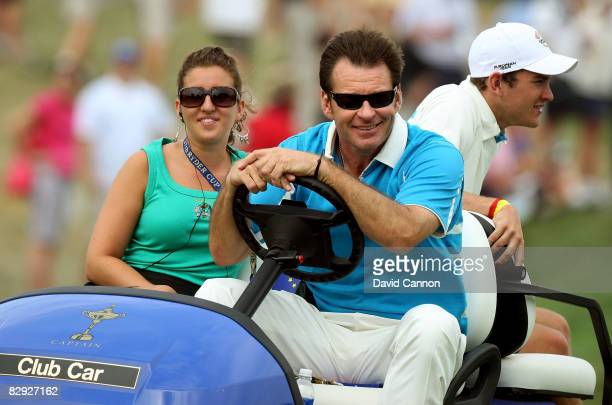 European team captain Nick Faldo rides with his daughter Natalie and son Matthew on the first tee during the afternoon fourball matches on day two of...