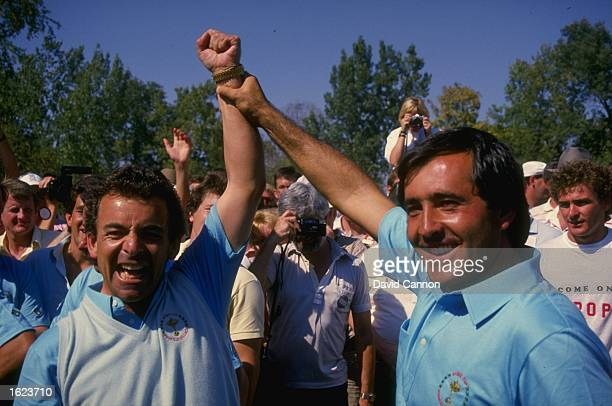 European team Captain Tony Jacklin of England and Seve Ballesteros of Spain raise their arms aloft in victory on the final day of the Ryder Cup at...