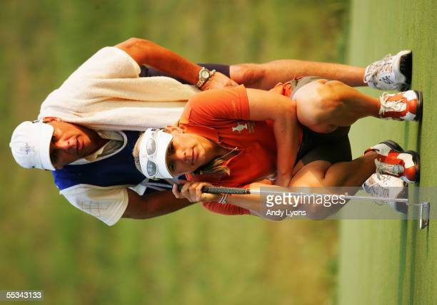 European Team member Annika Sorenstam of Sweden and her caddie Terry McNamara line up a putt on the 16th hole during her fourball match during the...