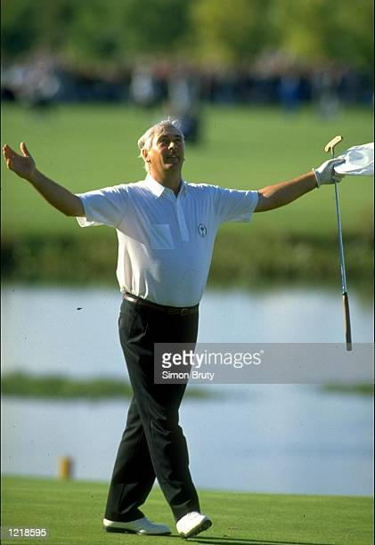 European team member Christy O''Connor Junior seals their victory by beating Fred Couples of the USA during the Ryder Cup at The Belfry golf Club in...