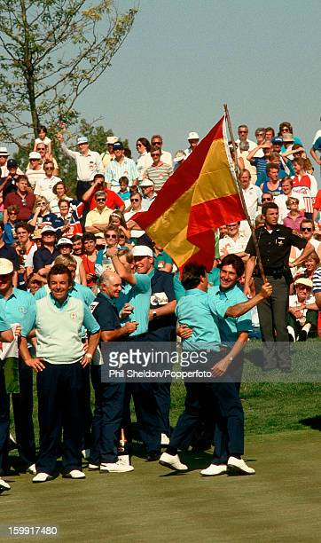 European Team members including captain Tony Jacklin and Spain's Jose Rivero and JoseMaria Olazabal celebrate their victory in the Ryder Cup golf...