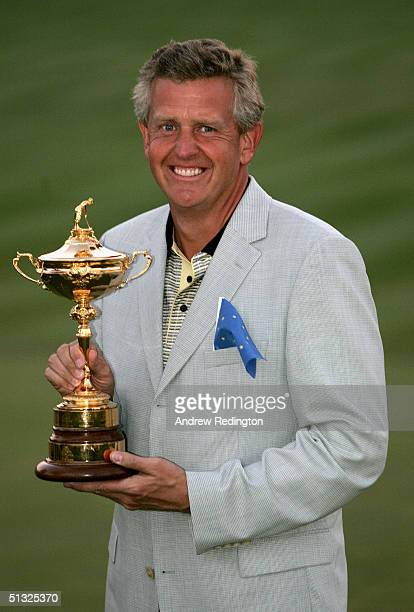 European team player Colin Montgomerie holds the trophy after Europ's 18 1/2 to 9 1/2 victory over the USA at the 35th Ryder Cup Matches at the...