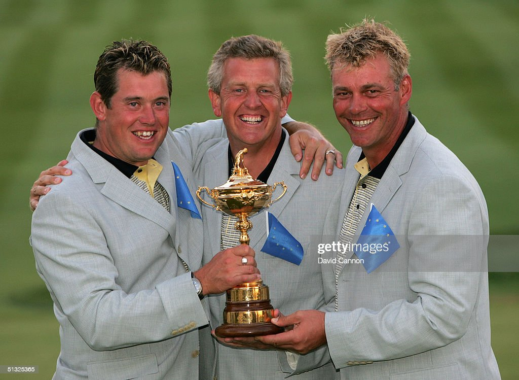 European team player Darren Clarke, Colin Montgomerie and Lee Westwood with the trophy after Europe's victory over the USA 18 1/2 to 9 1/2 at the 35th Ryder Cup Matches at the Oakland Hills Country Club on September 19, 2004 in Bloomfield Township, Michigan.
