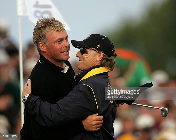 European team player Darren Clarke of Ireland celebrates with team captain Bernhard Langer after their foursome victory over Tiger Woods and Phil...
